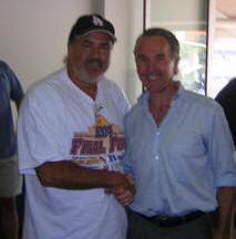 With former Dodger owner Frank McCourt